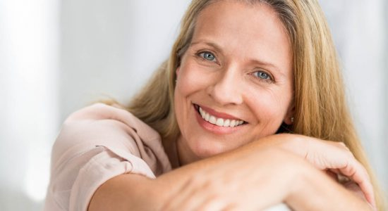 Smiling mature woman on couch